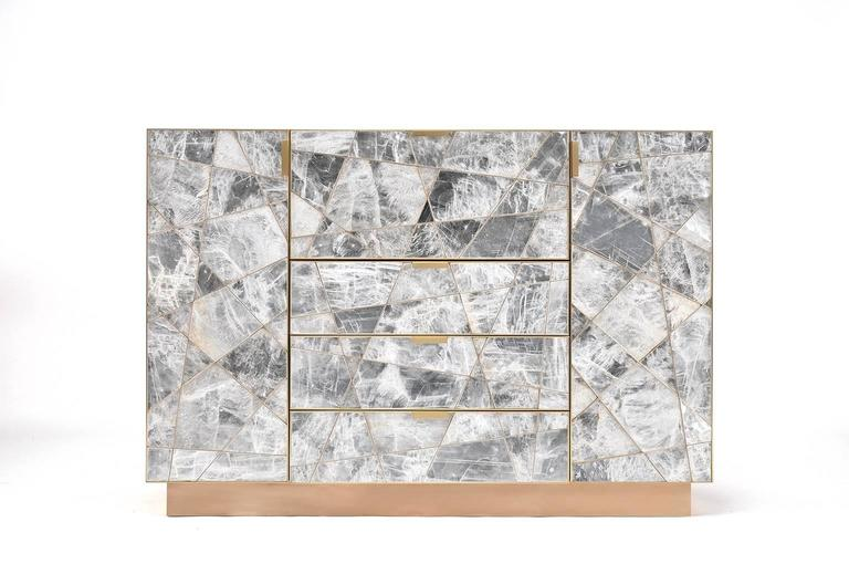 The Mosaic cabinet in selenite, bronze and claro walnut is a strikingly opulent example of a few of the most beautiful materials in the natural world that we have been given as furniture makers to work with. This particular Mosaic Cabinet is