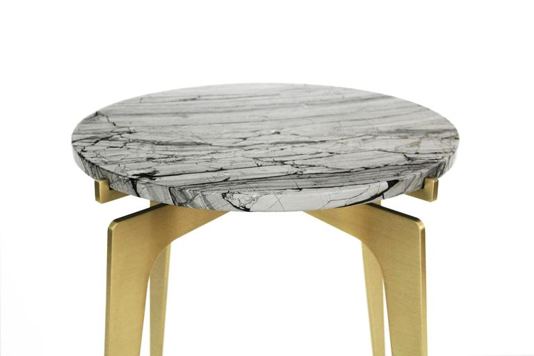 Inspired by precious stones and pronged settings found in precious jewelry, the Italian and Turkish marble tops available in the prong tables appear to be floating atop their tall legs.  Base available in black steel with brass hardware, in all