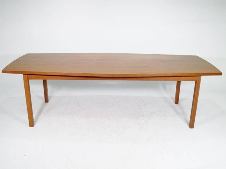 Danish conference table or dining table from the 1960s made in teak. Measures: W: 250 cm D: 108, 5 widest and 89 cm at the narrowest end H: 73 cm.