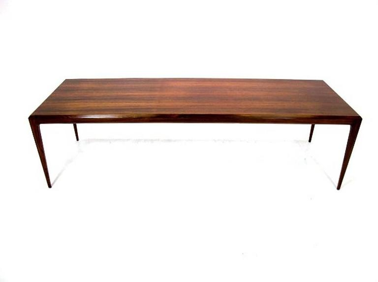 Very long narrow coffee table or bench designed by Johannes Andersen and manufactured by Silkeborg marked with the Danish Furniture Control made in the 1960s in rosewood.
