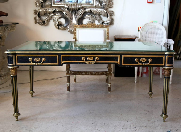 French, Napoleon III period, writing desk. Handmade in ebonized wood and cased with brass, ormolu.The top is covered with bevelled   glass.