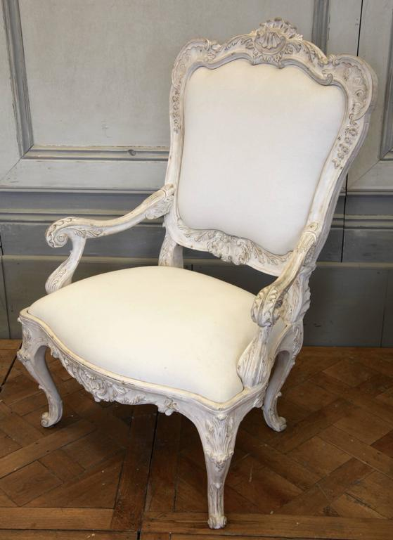 Re-edition of an 18th century Venetian armchair, hand-carved with beautifully crafted detailing. Hand finished in a gesso white patina, aged and distressed.