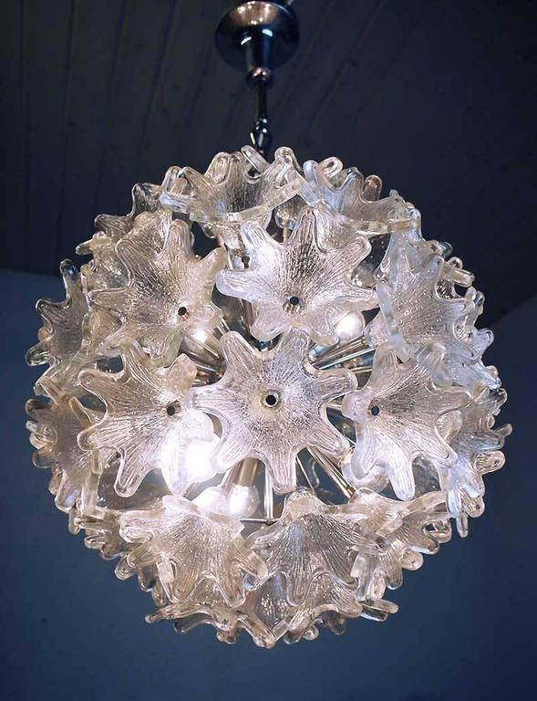 Large Murano sputnik ball chandelier by Paolo Venini for VeArt, Italy with 60 clear glass flowers. 