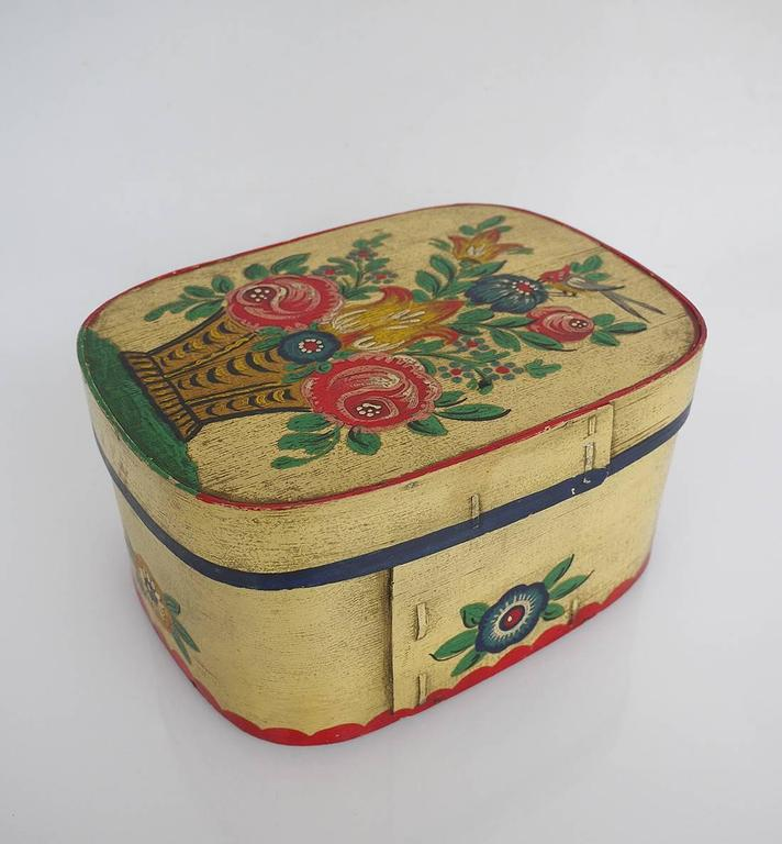 German painted wooden bride's box or container with tole painting made circa 1900.