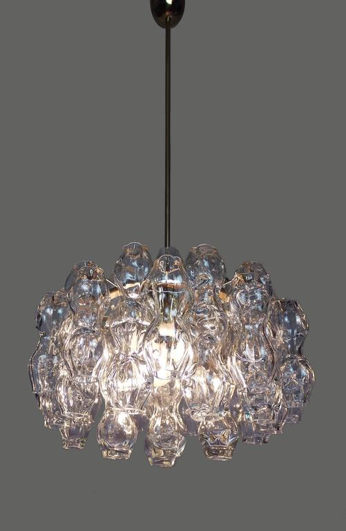 Blown Murano bubble glass chandelier made by Doria, Germany in the 1960s. Brass frame with three large Edison base bulbs. Labeled with Doria.