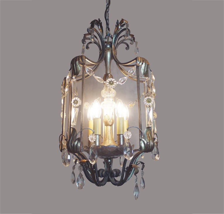 """Elegant Florentine crystal and wrought iron leaf chandelier by BF Art, Italy. The lamp takes five x small Edison bulbs. Measure: Diameter 15.75"""" / 40 cm, height 26"""" / 66 cm; with chain and canopy 59"""" / 150 cm."""