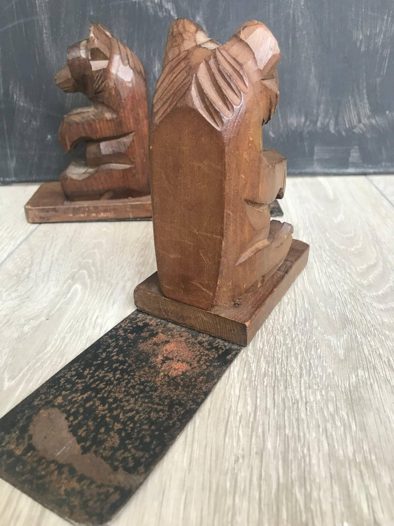 Rare and nice quality carved sitting bear bookstands.   These hand-carved bears with their curiously looking eyes are beautiful in both shape and color and they are a joy to own and look at. It is as if they have just performed a trick and they are