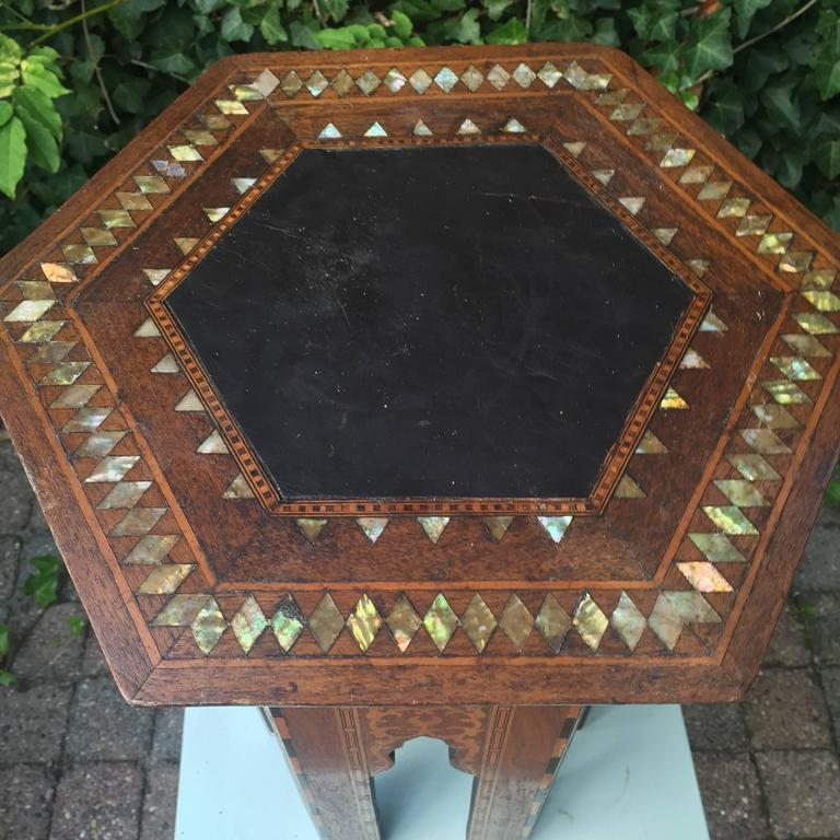 Beautiful antique Moorish table.   Moorish antiques have always appealed to not just people with an Arab background. The beautiful shapes, the warm colors and the quality of the craftsmanship is respected and appreciated the world over. This fine