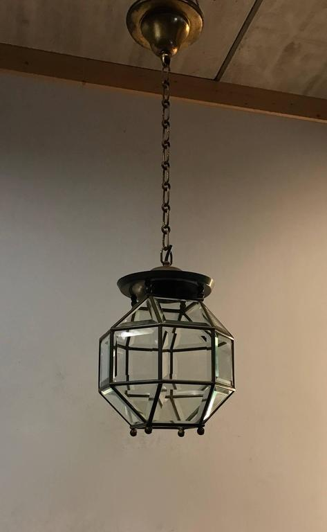 Excellent condition brass and bevelled glass lantern.  This stylish design is all handmade and in excellent condition. It has a total of twenty four rectangular, bevelled glass sections framed in brass and together they form a classy and timeless