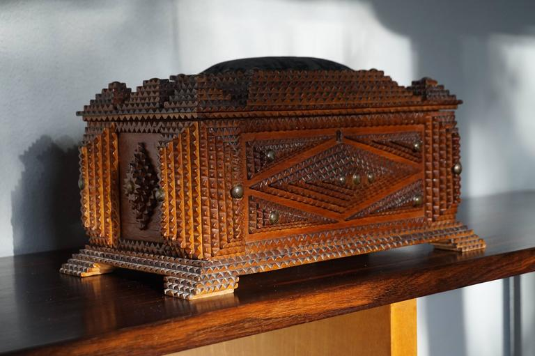Stunning sewing box in Gothic style.  This multi-layered and all handcrafted Tramp Art sewing box is an absolute joy to look at. This fine example dates from the late 19th century and apart from a minor loss at the bottom of two of the feet this box