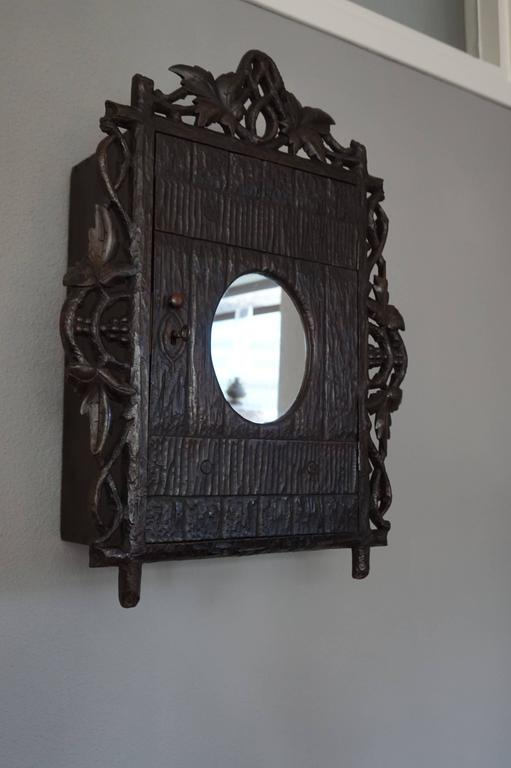 Antique And Hand Carved Black Forest Medicine Wall Cabinet
