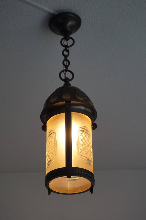 Rare and striking Art Nouveau pendant.  This stylish and lantern-like pendant is a joy to watch and it will create a beautiful atmosphere wherever you decide to use it. All hand-crafted in circa 1900 this rare light fixture has a wonderfully