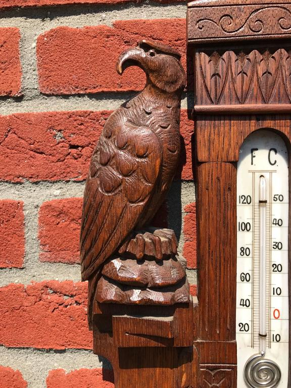 Highly decorative barometer and thermometer.  This handcrafted and sizeable barometer is another Fine piece of craftsmanship from the turn of the century. This early 20th century piece is all carved out of solid oak and it has a wonderful patina.