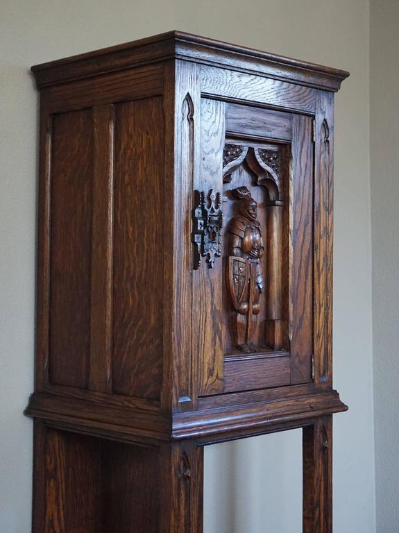 Marvelous and practical Gothic Revival drinks cabinet.  This rare Dutch Gothic dry bar is in excellent condition and it is beautifully carved. The Knight in full armor looks like he is guarding the gate of a castle, because the door of this cabinet