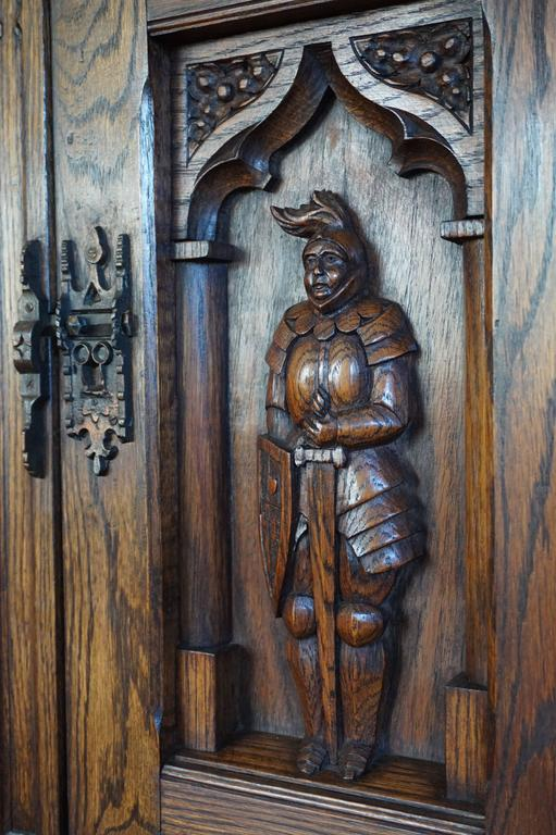 Wood Gothic Revival Oak Dry Bar / Hallway Cabinet with Carved Knight & Cast Iron Lock For Sale