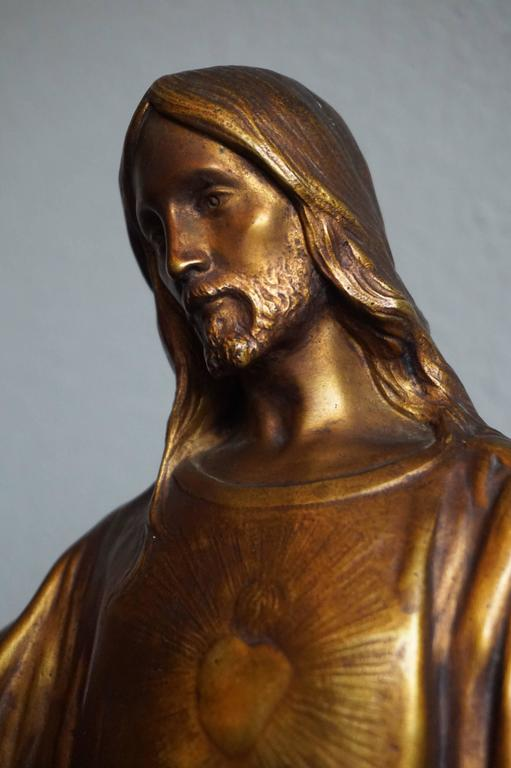 Stunning and large religious work of art.  The fine details and the perfectly natural poisture of this amazing Christ sculpture reveal the work of a master sculptor. This bronze 'statuette' of the sacred heart of Jesus is both gilt and patinated and