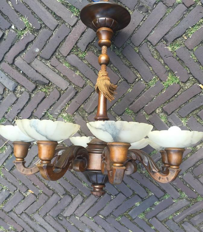 Early 1900s Hand-Carved Wooden Pendant / Chandelier with Fine Alabaster Shades In Excellent Condition For Sale In Lisse, NL