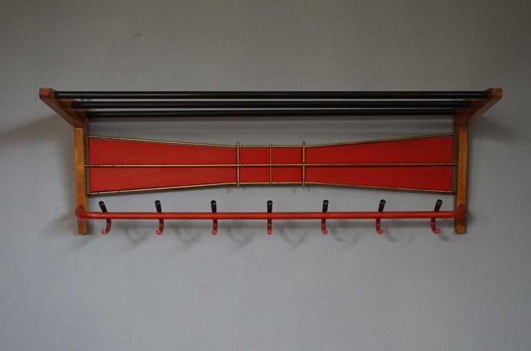 European Mid-Century Modern Wood, Brass and Plastic, Red and Black Coat and Hat Rack For Sale