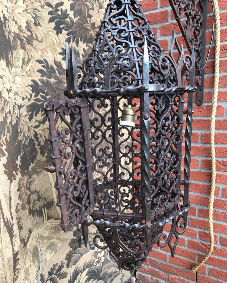 Unique, stunning and all handcrafted work of antique lighting art.  The amount of time that must have gone into designing and hand-forging this Moorish style light fixture is incredible. There are so many, individually forged and perfectly shaped