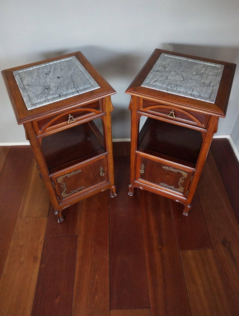 Rare and wonderful 'Ecole de Nancy' style nightstands.  Pure Art Nouveau nightstands are very hard to find and we felt blessed (again) to be given the opportunity to buy this pair. This sizable and beautifully designed pair is almost entirely made