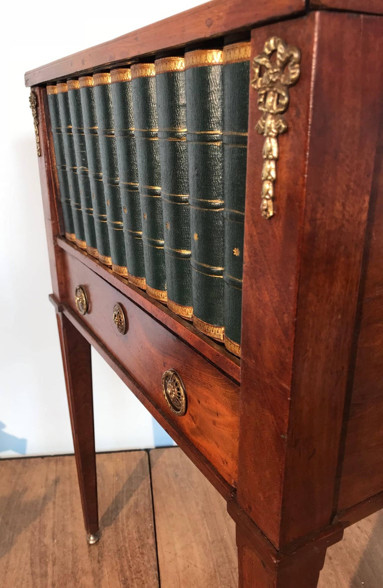 Empire Style Mahogany End Table With Faux Books Rolling