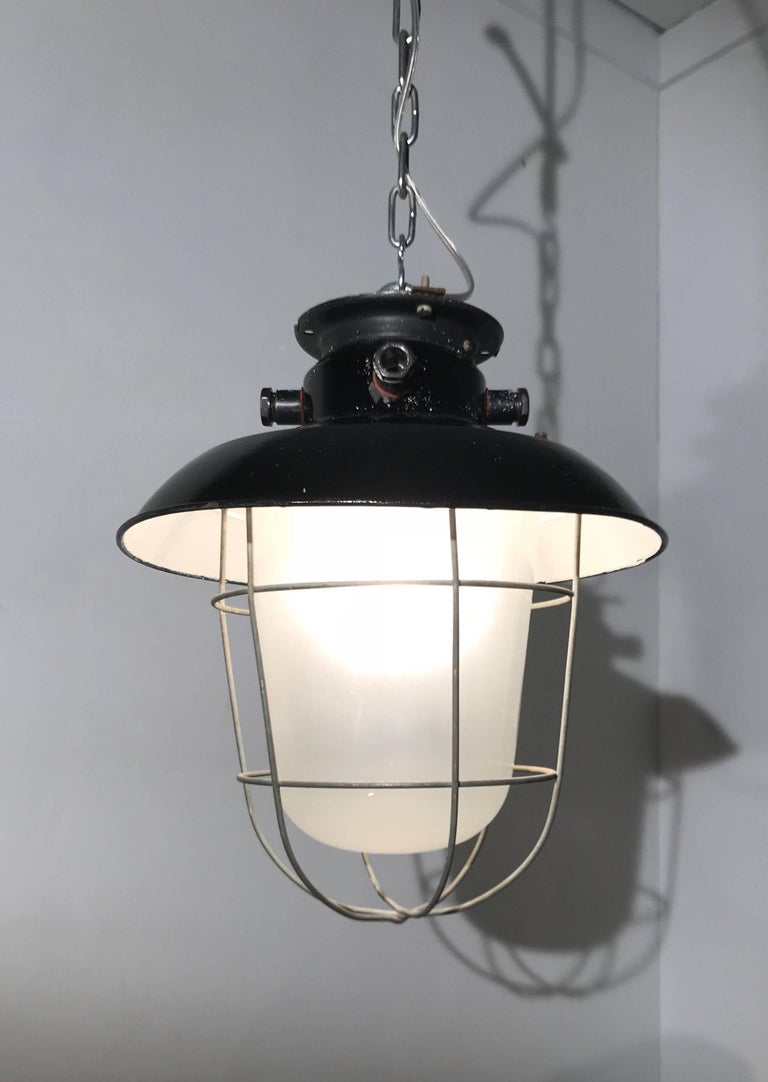 1920s Matching Pair of Industrial, Glass & Black Enamel Caged Light Pendant In Good Condition For Sale In Lisse, NL