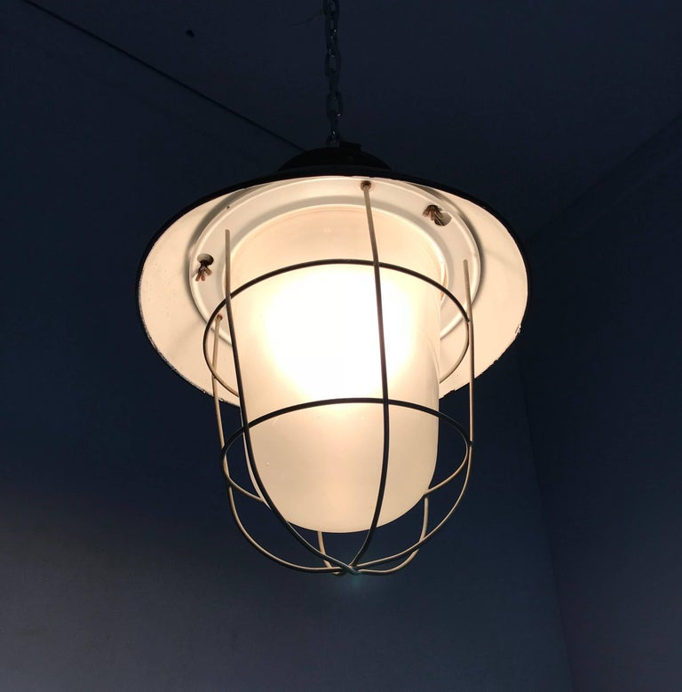 Metal 1920s Matching Pair of Industrial, Glass & Black Enamel Caged Light Pendant For Sale