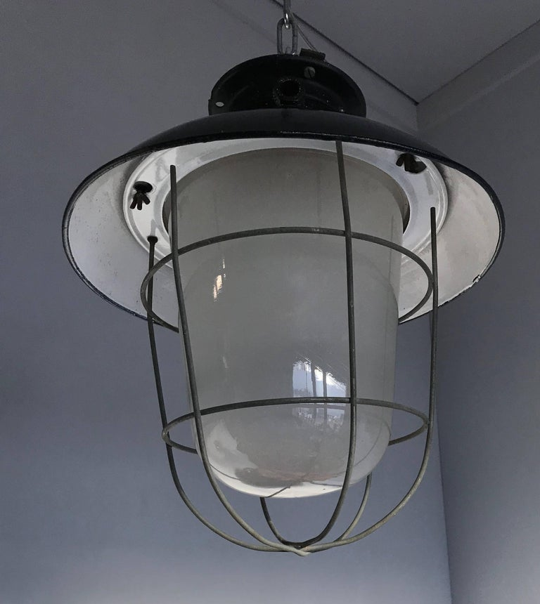 1920s Matching Pair of Industrial, Glass & Black Enamel Caged Light Pendant For Sale 1