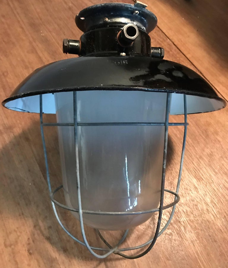 1920s Matching Pair of Industrial, Glass & Black Enamel Caged Light Pendant For Sale 3