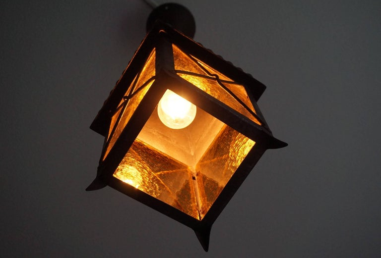 20th Century Early 1900s Arts and Crafts Wrought Iron and Cathedral Glass Lantern For Sale
