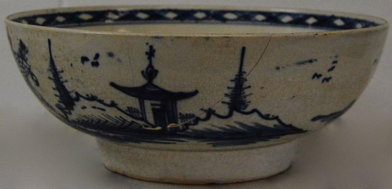 We are offering you a beautiful oriental bowl done in white porcelain with blue hand painted scenes. This bowl originates from the late 18th century. This would make a great addition to your Chinese collectibles.