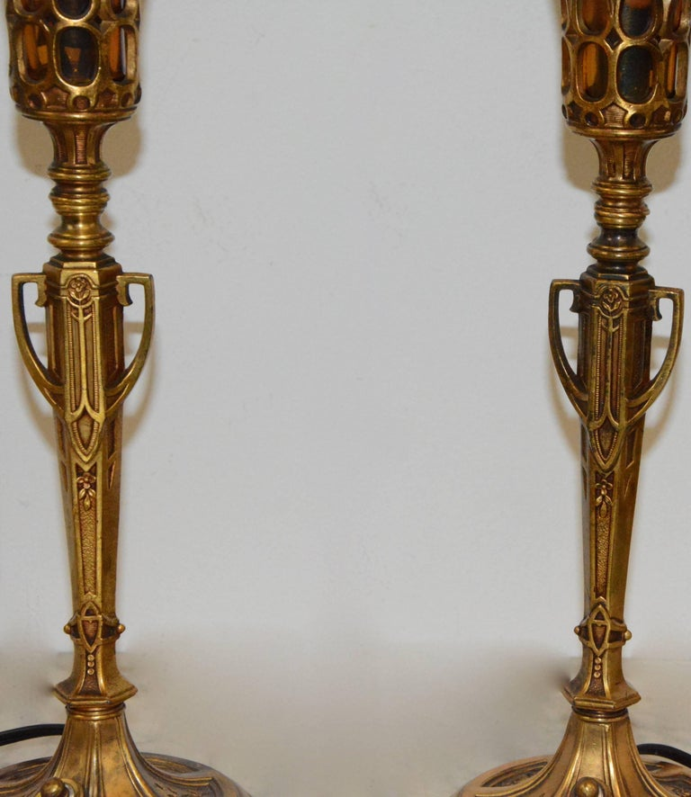 Cast Art Deco Bronze Lamps with Iridescent Shades For Sale
