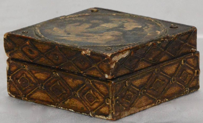 This is a fabulous wooden box is decorated with Madonna and child on the top. Adding to the elegance is the gilt finish on the sides featuring a diamond pattern. The top opens up to unfinished wood.