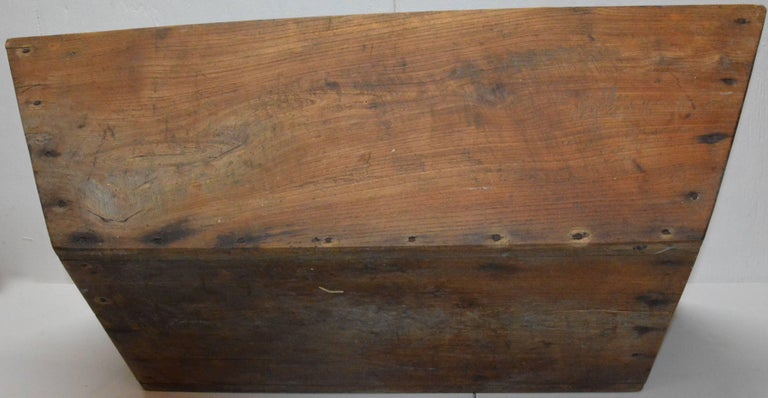 This is an unfinished Primitive style trough constructed of walnut with angled sides and completed with nails. This would be a fabulous centerpiece for your massive table with many options for decorating with it.