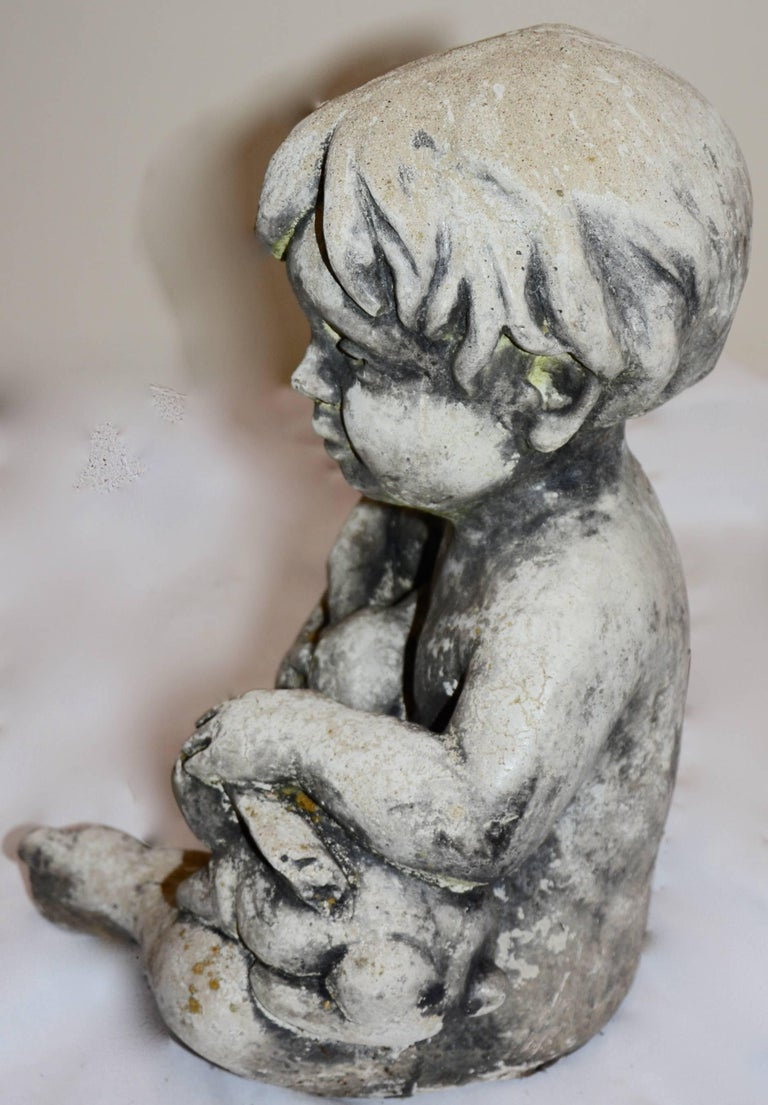 20th Century Cast Stone Statue of Baby Holding Bunnies For Sale