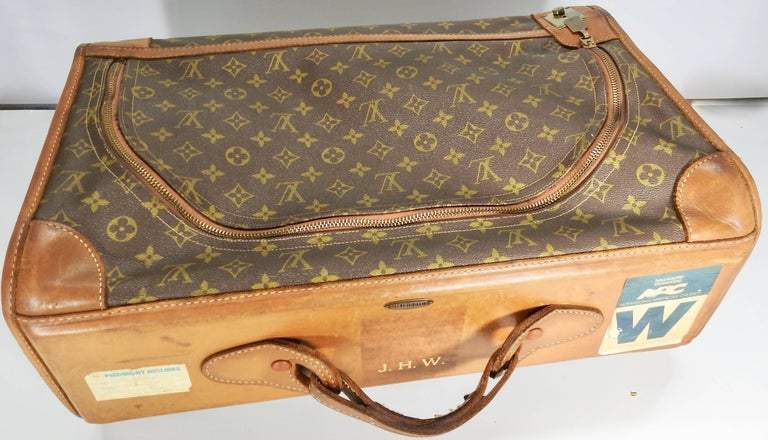 We are offering a Classic Louis Vuitton soft overnight case. It has the  initials J.H.W. 1ed19c7c963bc