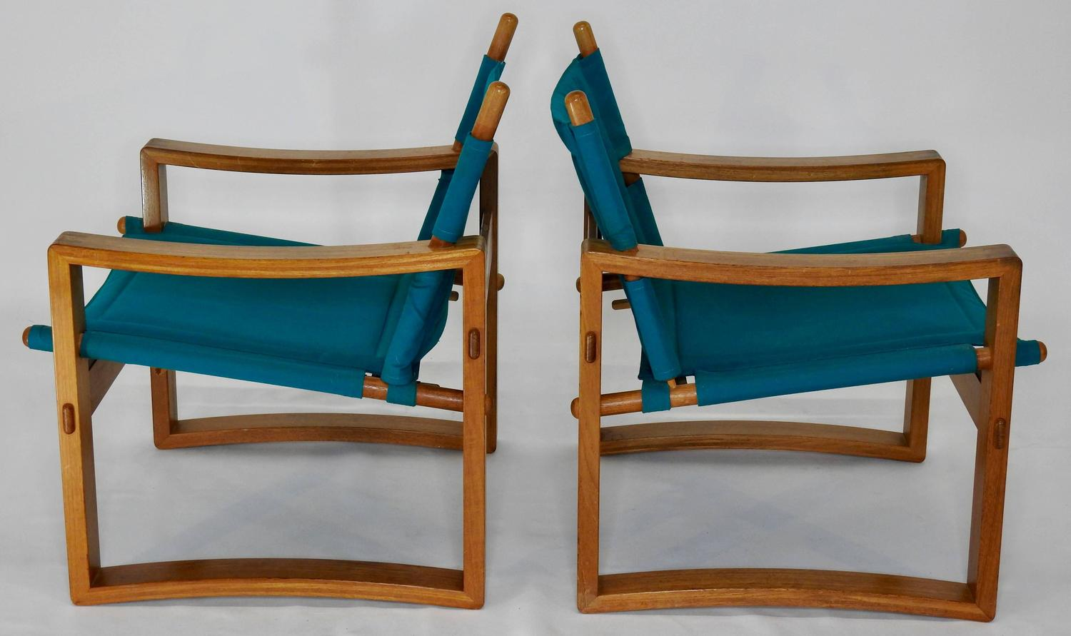 Pair of mid century teal lounge chairs with leather straps for Teal chairs for sale