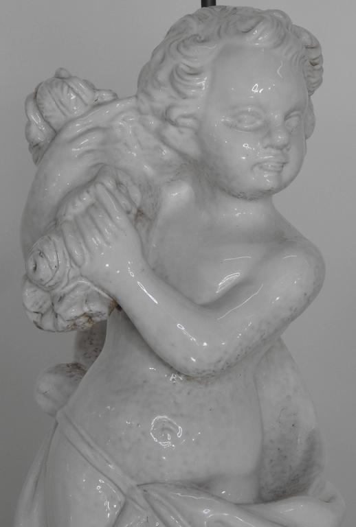 White Glazed Terracotta Cherub Lamps on Wooden Bases, Pair In Good Condition For Sale In Cookeville, TN