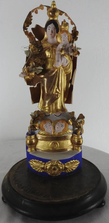We are offering a stunning pair of religious sculptures made of polychrome and gilded porcelain bisque which have been accented with lots of detailing. The figures are enhanced with paper and fabric flowers. Hand painting brings out the beauty of