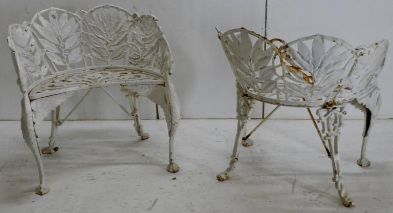 Winged Griffin legs support this lovely set of side chairs featuring a leaf pattern. This would be a great addition to your garden. This is a pattern that is unique and the details are fabulous!