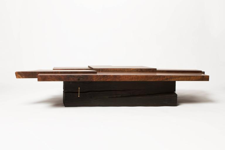 American Modern Claro Walnut Strike or Slip Coffee Table with Brass and Charred Beam Base For Sale