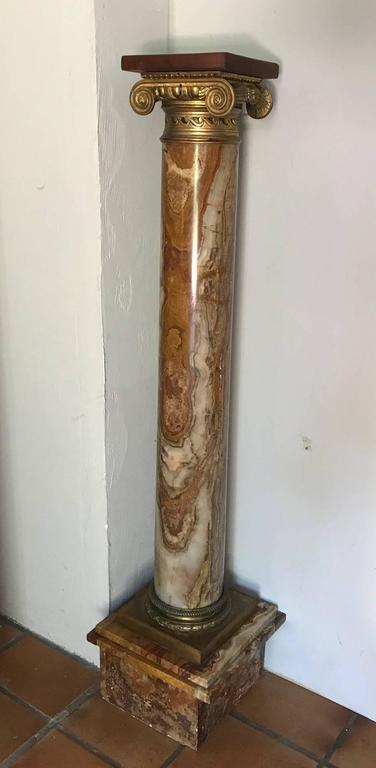 A beautiful breccia rouge royale marble and ormolu-mounted ionic pedestal column. Replaced wooden plinth.