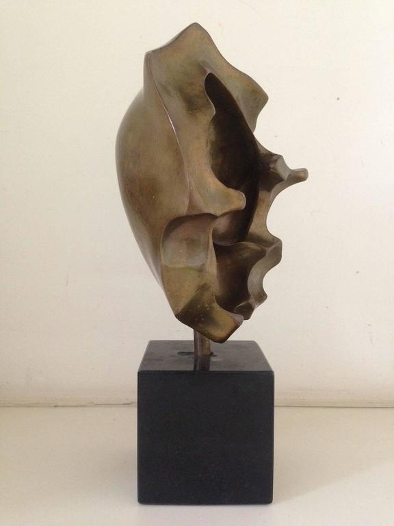 A beautiful and powerful small bronze abstract sculpture on black marble base by Francois Kovacs. Numbered 15/35 and signed Francois Kovacs.  Kovacs was a Belgian Sculptor and artist, originally from Hungary. Born into a poor family, he began