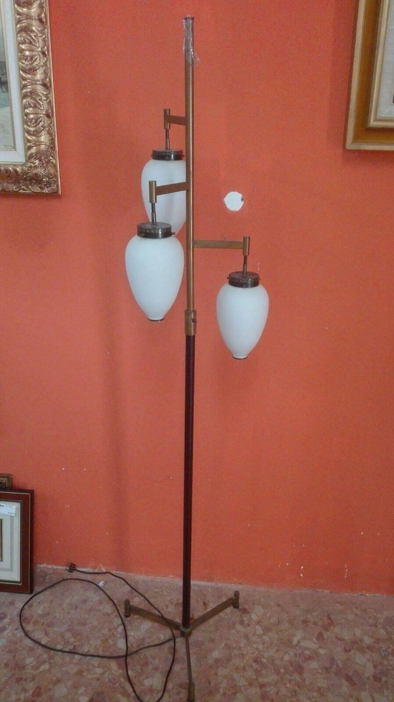Beautiful and elegant floor lamp with brass stem, three white opal white lamp shades and brass inserts that give a nice effect when the lamp is on.