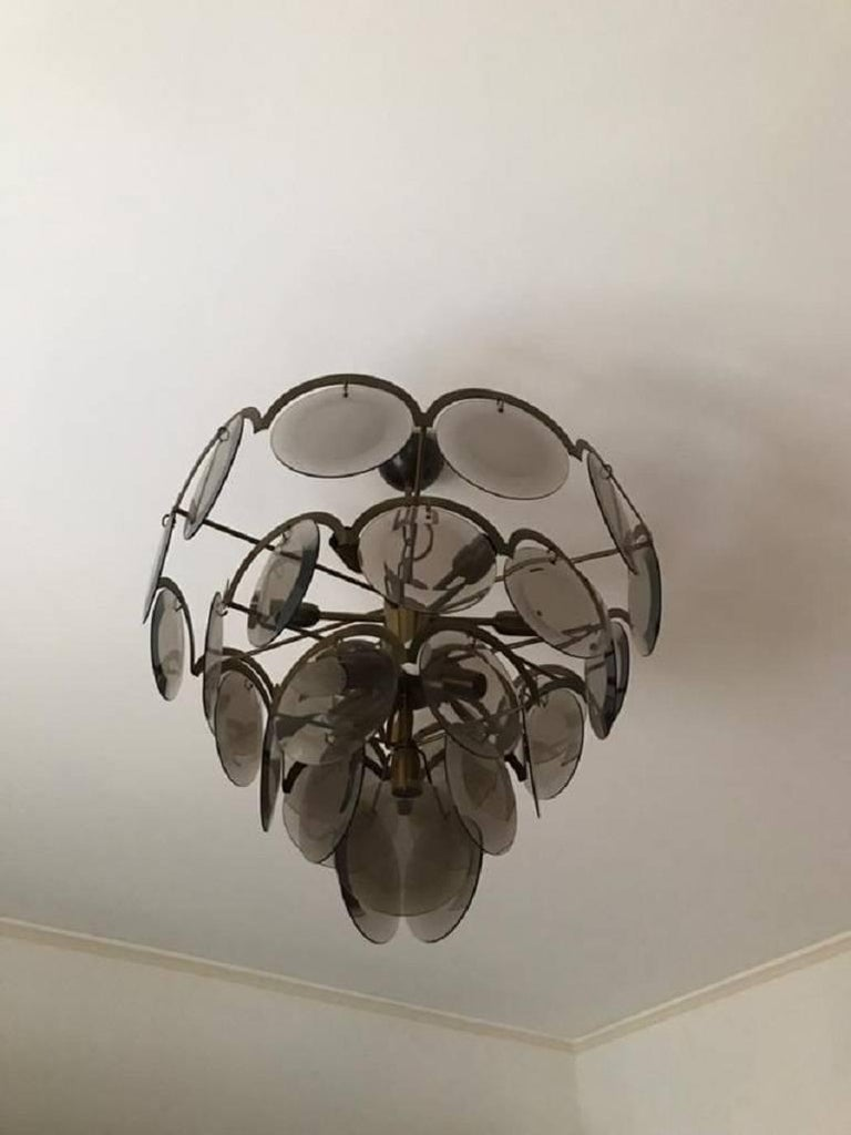 Mid-Century Modern Chandelier at five levels in chromed metal and smoke glass, Italy, 1970s For Sale