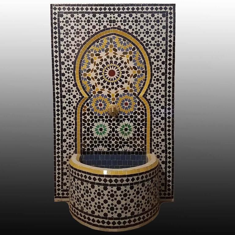 "Moroccan glazed multicolored (Fez tradition) fountain made in Morocco. Measures: Approximately 50"" high and 30"" wide, and comes with a copper spout and an electric pump. Great for outdoors/indoors.