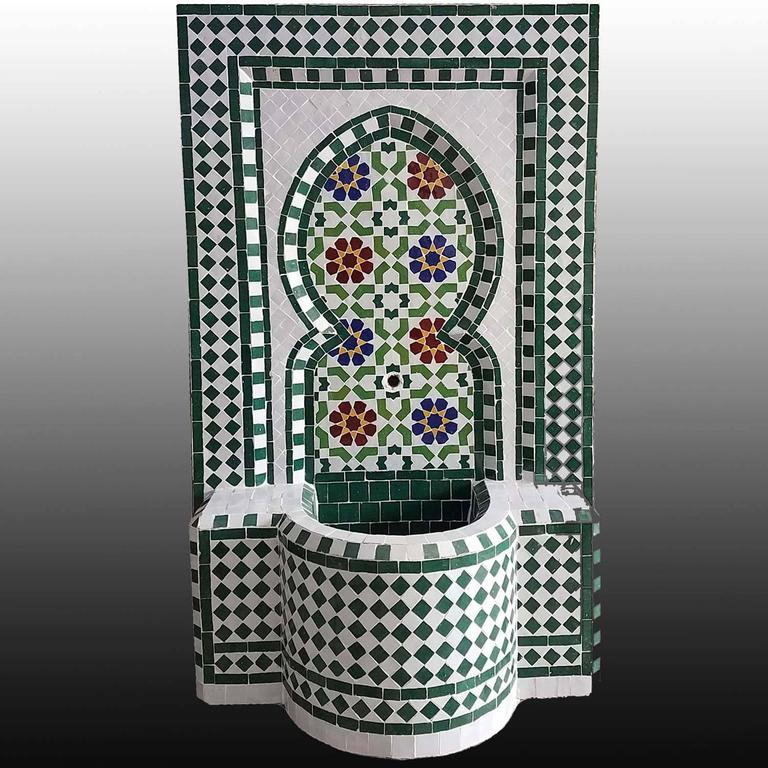 Very typical colorful Moroccan mosaic fountain handmade in Morocco. This fountain is usually found in courtyards and Riads all over Morocco. It measures approximately 40? high and 26? wide and weighs about 200 lbs. Boar's head copper spout is