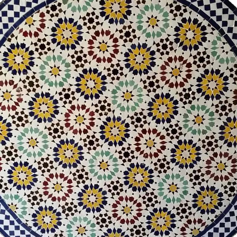 Multicolor custom-made Moroccan mosaic table measuring 48? in diameter. An indoor / outdoor dining table that sits up to six people. Very intricate design involving six different colors, a very typical pattern known to Morocco for centuries. This
