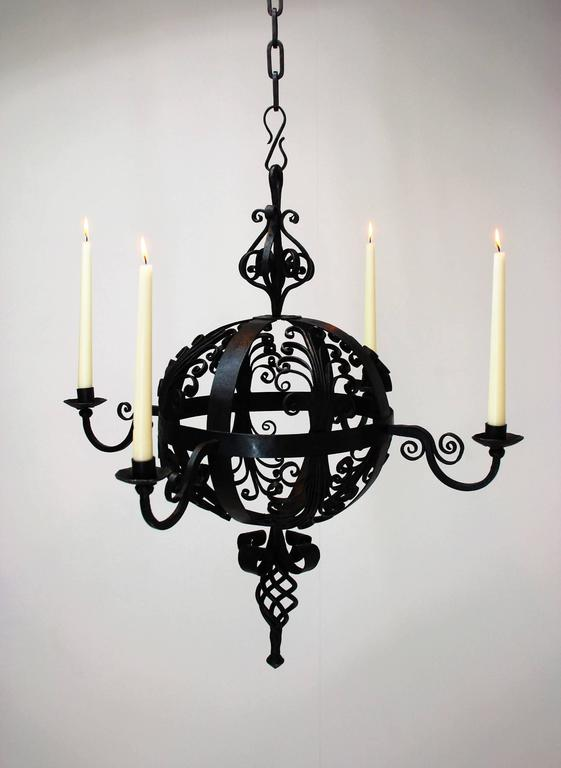 A very nice decorative wrought iron chandelier, early 19th century with nice black patina. Our technical team can provide this lamp with electrical lighting on request.