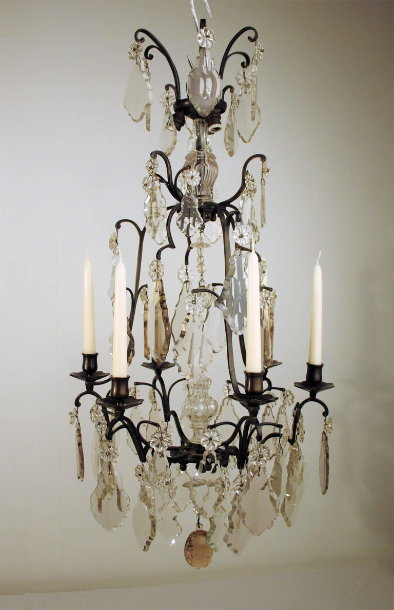Beautiful completely original French 18th Century Louis XV crystal Chandelier. This Chandelier has been completely restored and still has its original crystal that is light pink colored because the old crystal contained more lead. At the top of the